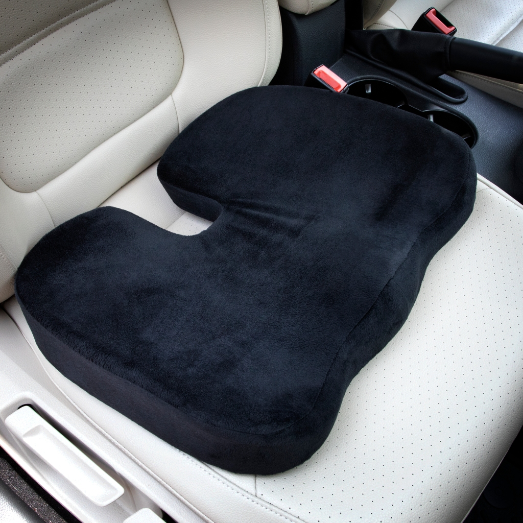 image of a 100% memory foam seat cushion. This cushion is placed on a car seat showing how it should be placed, U-shape design against the back of chair